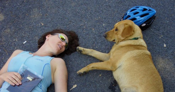 Lisa rests with a new friend after a multi-sport race.