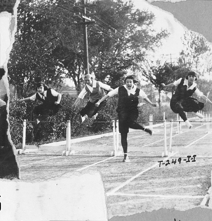 Women doing hurdles in skirts.