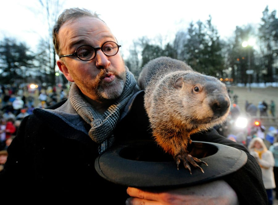 Phil's handler would fit in well with a tweed ride. (photo courtesy of MSNBC)