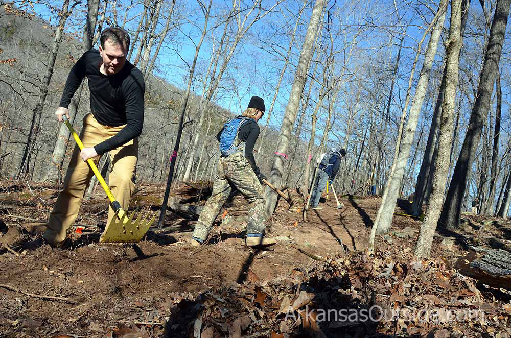 Volunteers working with IMBA on a new trail at Devil's Den State Park.