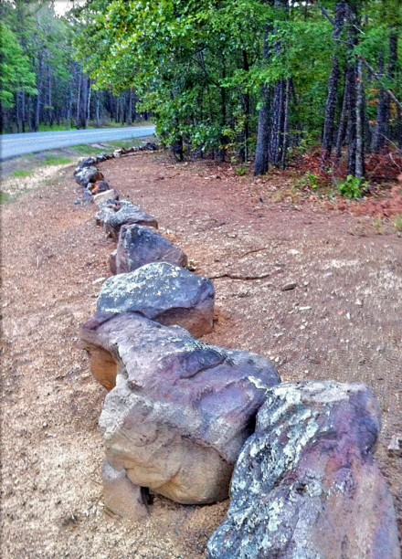 When entering or exiting the trail, stay on the wood side of these rocks.