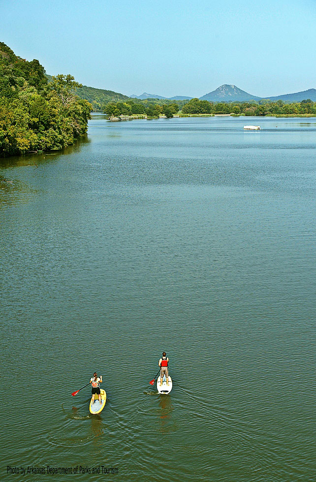 Stand Up Paddleboarding with Pinnacle Mountain in the background.