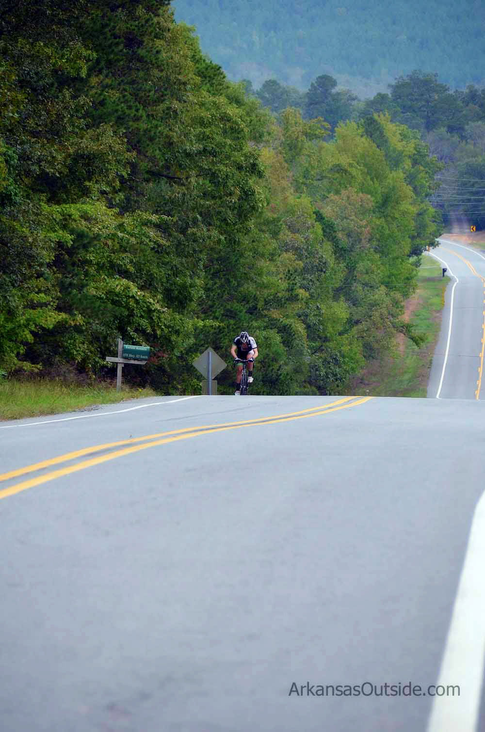 A lone rider makes the final climb on Wye Mountain.