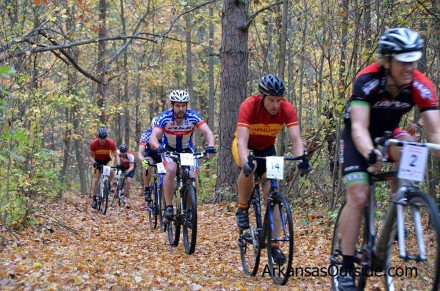 The Cat 4, Masters, Juniors, Women's race coming through the wooded section for the first time.