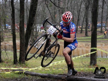 Alex Bumpers of Team Arkansas Cycling & Fitness hurdles the log barriers.