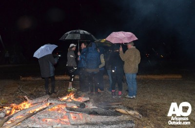 Volunteers, fans and team members took advantage of one of two bonfires to keep warm.