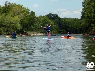 Being one with paddleboard and river. Yoga moves on the board.