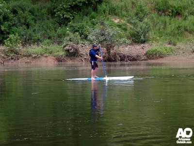 Bryan gives the paddleboard a go. Bryan gave the river a go just 2 seconds after this photo.