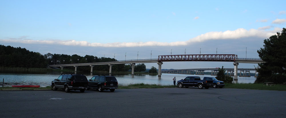 View of the Two Rivers Bridge from the boat ramp parking lot.