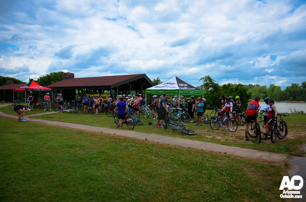 Over 50 female cyclists, getting ready to ride.