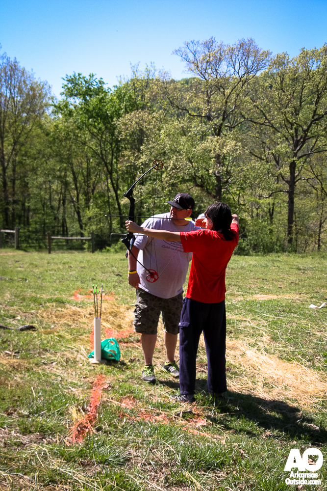 Getting some archery instruction. (photo by Cliff Li)