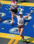 Cortney finishing the Boston Marathon.