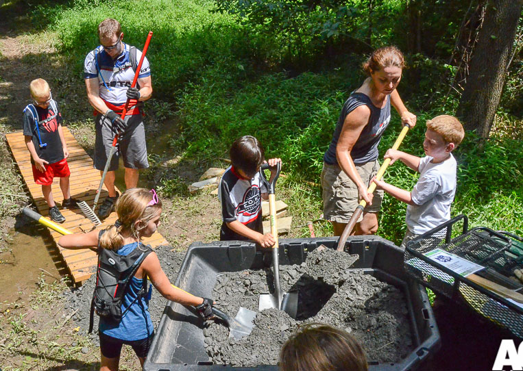 Showing the kids how the business end of a shovel works during a recent trail work day.