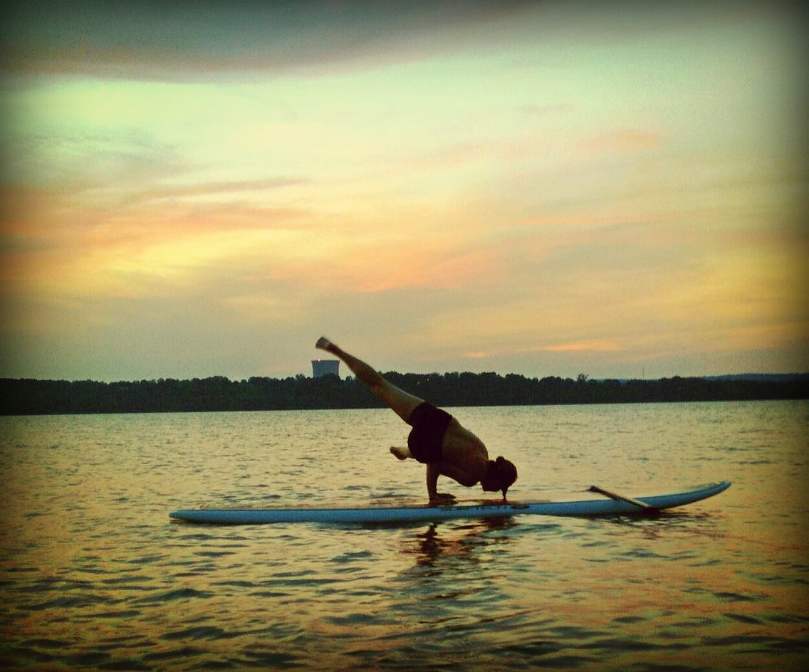 AO Friend Tammy demonstrates how she mixes Yoga and Stand Up Paddle boarding on Lake Dardanelle.
