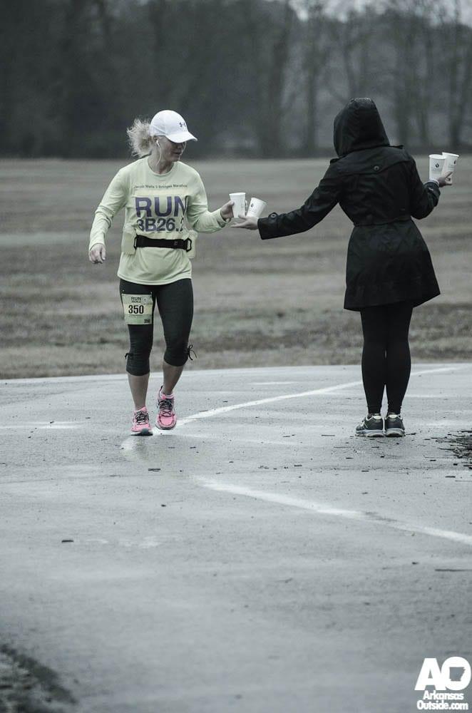 Christine services a runner.