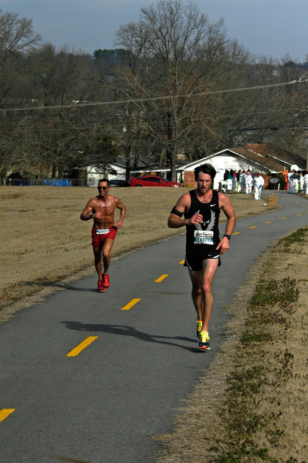 Randy Johnson, left, trails Cody Skarupa at Mile 13 of the Fort Smith Marathon.