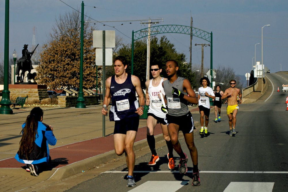 Collegiate relay teams push the early pace.