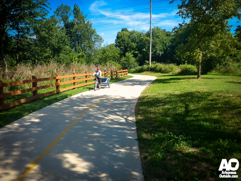 Mom pulling her child along the Greenway.