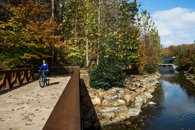 A rider on the Razorback Greenway in Bentonville, Arkansas, outside the Crystal Bridges Museum of American Art. (Bike NWA)
