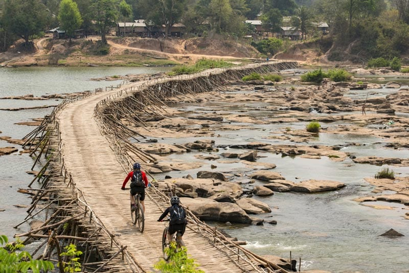 Rebecca Rusch and Huyen Nguyen ride the Ho Chi Minh Trail for the feature film project 'Blood Road' in Vietnam, Laos, and Cambodia in March, 2015. Project / Event: