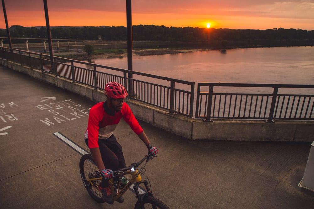 Mountain Biker crossing the Big Dam Bridge